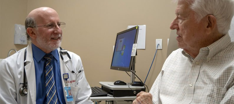 Dr. Greg Sachs consulting with a patient