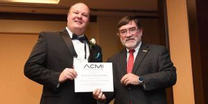 Brian Dixon accepts FACMI award