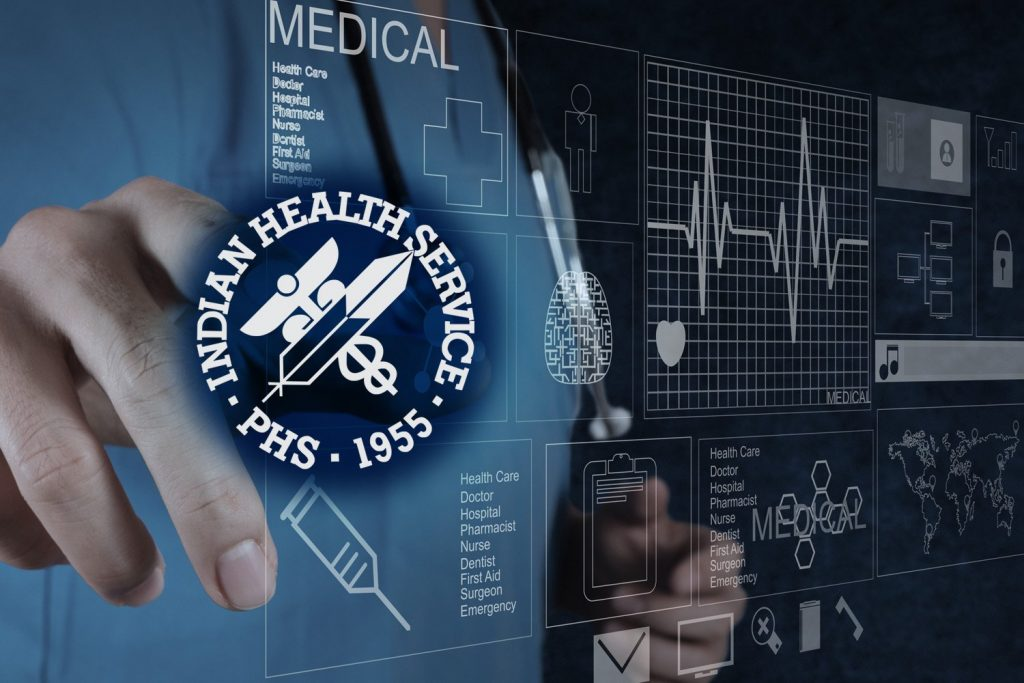 image of a doctor using electronic health record overlaid with IHS logo