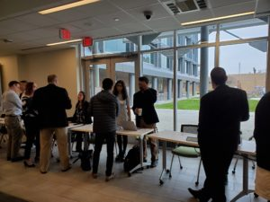Attendees network to discuss implementing AI