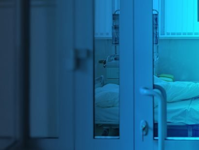 Intensive care unit behind closed glass door