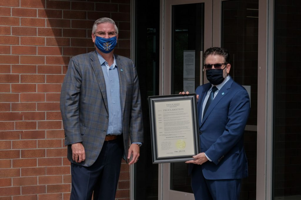 Dr. Peter Embi and Gov. Eric Holcomb with proclamation of Regenstrief Institute Recognition week